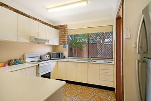 The Kitchen of Centennial Terrace Apartments Standard 2 Bedroom Unit.