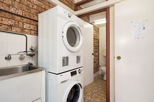 The Laundry of Centennial Terrace Apartments Standard 2 Bedroom Unit.