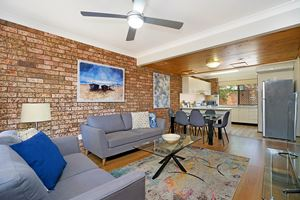 The Living Room of Centennial Terrace Apartments Standard 2 Bedroom Unit.